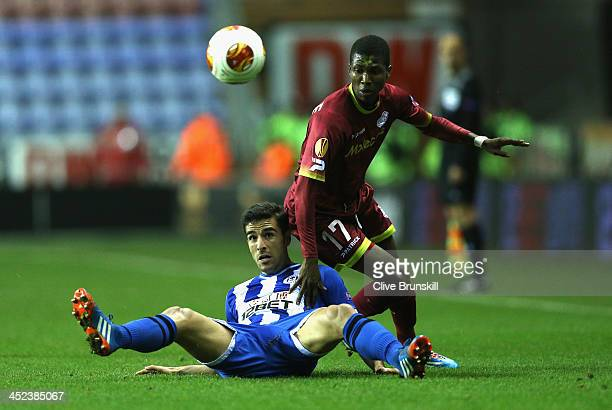 Jordi Gomez of Wigan Athletic in action with Ibrahima Conte of SV Zulte Waregem during the UEFA Europa League Group D match between Wigan Athletic...
