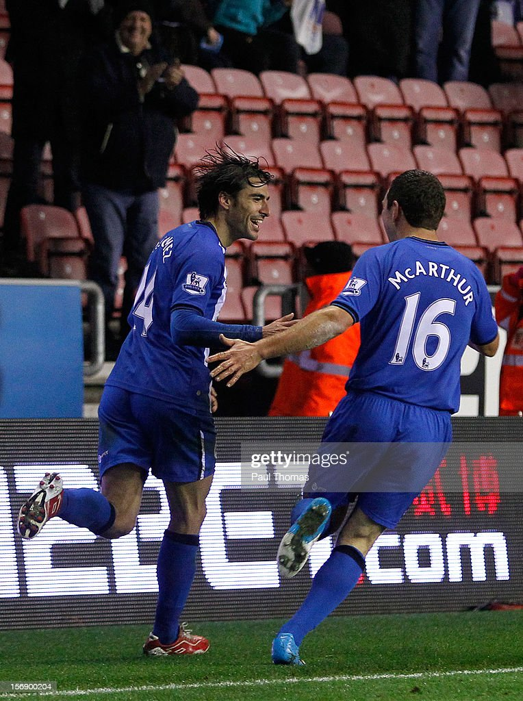 <a gi-track='captionPersonalityLinkClicked' href=/galleries/search?phrase=Jordi+Gomez&family=editorial&specificpeople=1323748 ng-click='$event.stopPropagation()'>Jordi Gomez</a> (L) of Wigan celebrates after scoring his third goal with team mate James McArthur during the Barclays Premier League match between Wigan Athletic and Reading at the DW Stadium on November 24, 2012 in Wigan, England.
