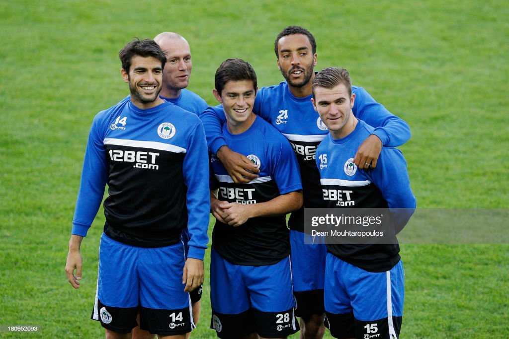Jordi Gomez Stephen Crainey Daniel Redmond James Perch and Callum McManaman have a laugh together during the Wigan Athletic Training Session prior to...