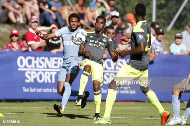 Jordi Mboula of AS Monaco Joshua Brenet of PSV during the friendly match between AS Monaco and PSV Eindhoven at Stade StMarc on July 16 2017 in...