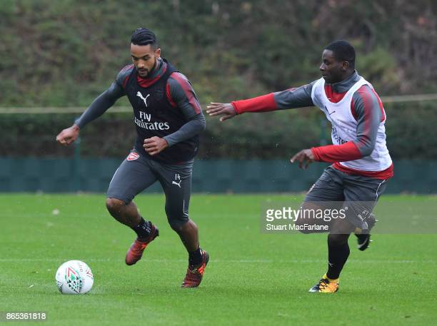 Jordi OseiTutu and Theo Walcott of Arsenal during a training session at London Colney on October 23 2017 in St Albans England