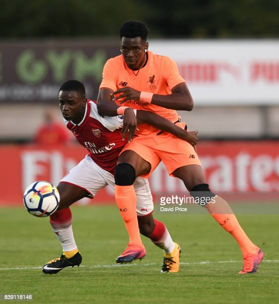 Jordi OseiTutu of Arsenal is challenged by Ovie Ejaria of Liverpool during the match between Arsenal and Liverpool at Meadow Park on August 25 2017...