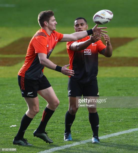 Jordie Barrett catches the ball as Ngani Laumape looks on during the New Zealand All Blacks captain's run at Eden Park on July 7 2017 in Auckland New...