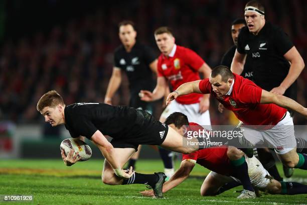 Jordie Barrett of the All Blacks dives forward during the Test match between the New Zealand All Blacks and the British Irish Lions at Eden Park on...