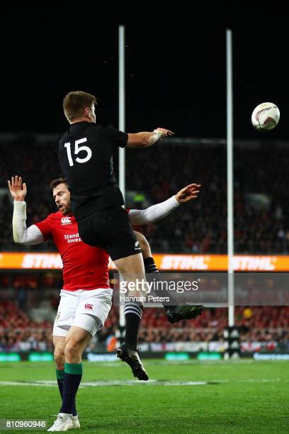 Jordie Barrett of the All Blacks flicks the ball back in play during the Test match between the New Zealand All Blacks and the British Irish Lions at...