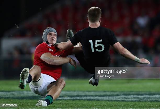 Jordie Barrett of the All Blacks is tackled by Jonathan Davies during the Test match between the New Zealand All Blacks and the British Irish Lions...
