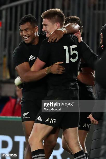 Jordie Barrett of the All Blacks scores a try congratulated by Julian Savea during the Test match between the New Zealand All Blacks and the British...