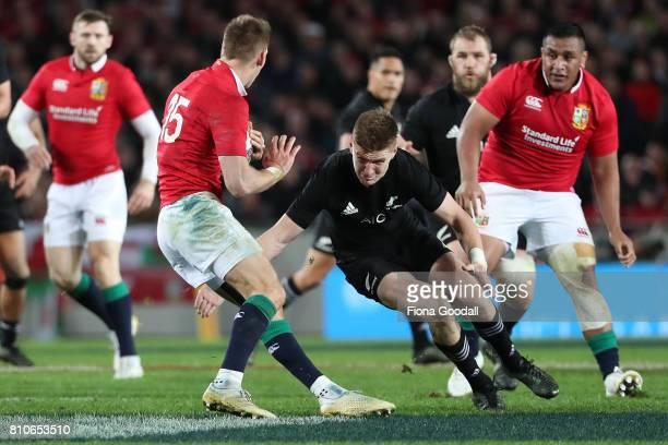 Jordie Barrett of the All Blacks tackles Liam Williams of the Lions during the Test match between the New Zealand All Blacks and the British Irish...