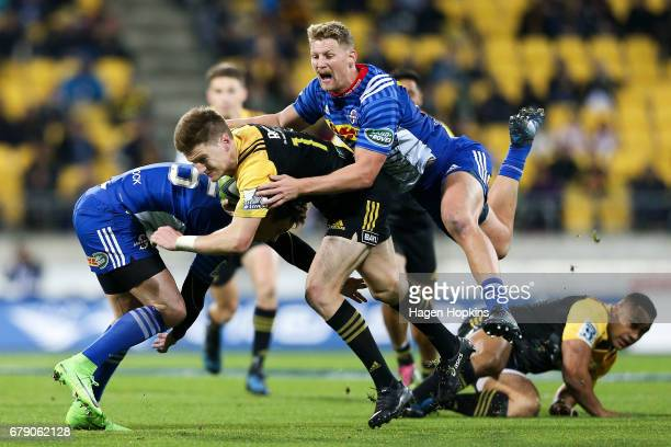 Jordie Barrett of the Hurricanes is tackled by Robert du Preez of the Stormers during the round 11 Super Rugby match between the Hurricanes and the...