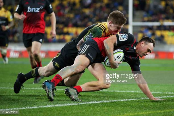 Jordie Barrett of the Hurricanes tackles Israel Dagg of the Crusaders into touch during the round 17 Super Rugby match between the Hurricanes and the...