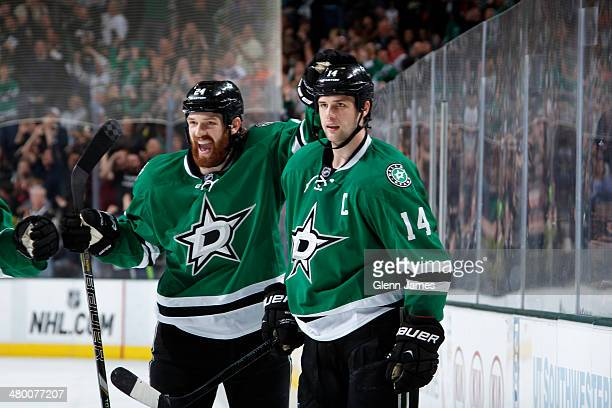 Jordie Benn and his brother Jamie Benn of the Dallas Stars celebrate a goal against the Ottawa Senators at the American Airlines Center on March 22...