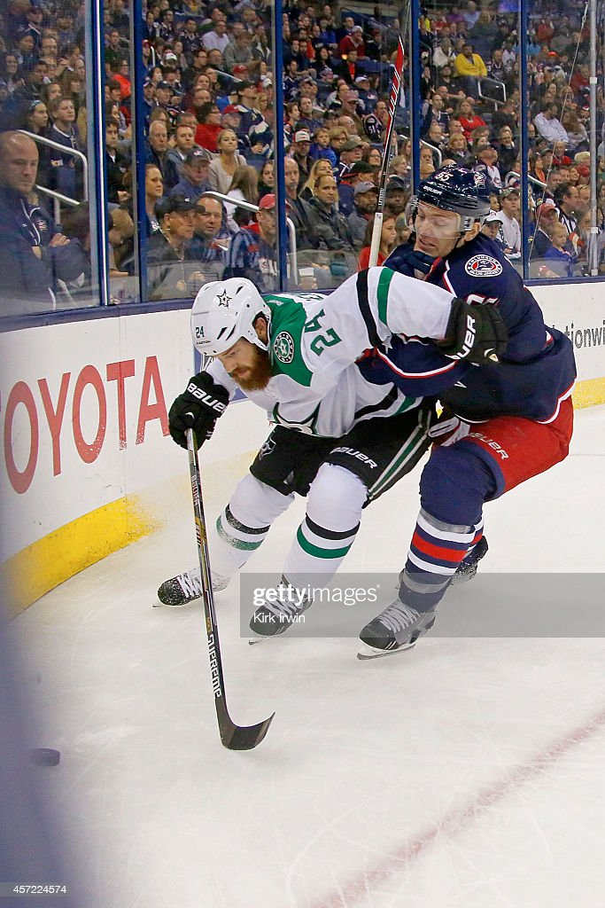 Jordie Benn #24 of the Dallas Stars and Mark Letestu #55 of the Columbus Blue Jackets battle for control of the puck during the second period on October 14, 2014 at Nationwide Arena in Columbus, Ohio. Dallas defeated Columbus 4-2.