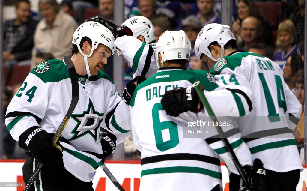 Jordie Benn #24 of the Dallas Stars celebrates teammate Valeri Nichushkin's #43 goal against the Vancouver Canucks with Trevor Daley #6 and Jamie Benn #14 during the first period of their NHL game at Rogers Arena on November 17, 2013 in Vancouver, British Columbia, Canada.
