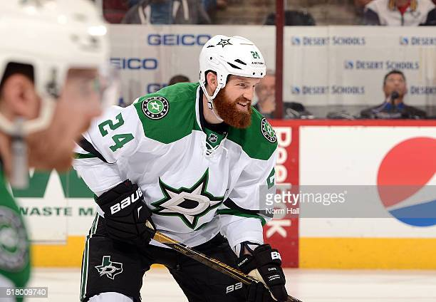 Jordie Benn of the Dallas Stars gets ready during a faceoff against the Arizona Coyotes at Gila River Arena on March 24 2016 in Glendale Arizona