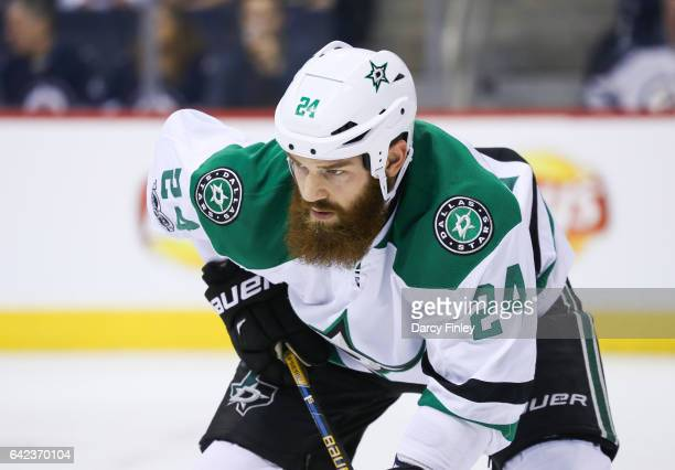 Jordie Benn of the Dallas Stars gets set during a first period faceoff against the Winnipeg Jets at the MTS Centre on February 14 2017 in Winnipeg...