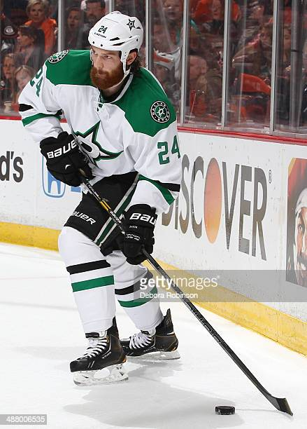 Jordie Benn of the Dallas Stars handles the puck against the Anaheim Ducks in Game Five of the First Round of the 2014 Stanley Cup Playoffs at Honda...