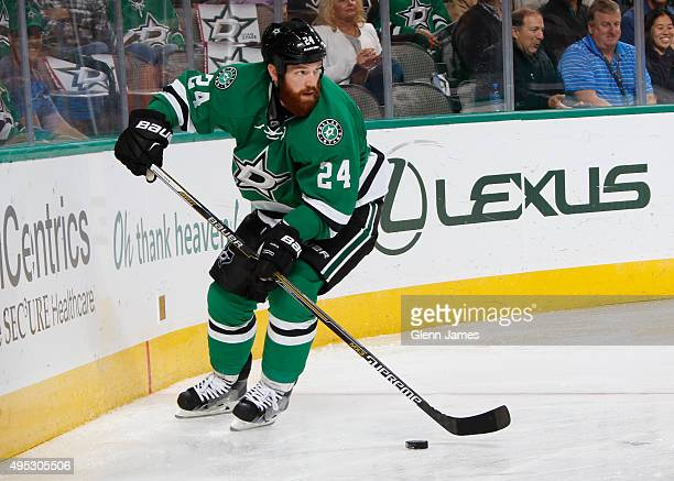 Jordie Benn of the Dallas Stars handles the puck against the Anaheim Ducks at the American Airlines Center on October 27 2015 in Dallas Texas