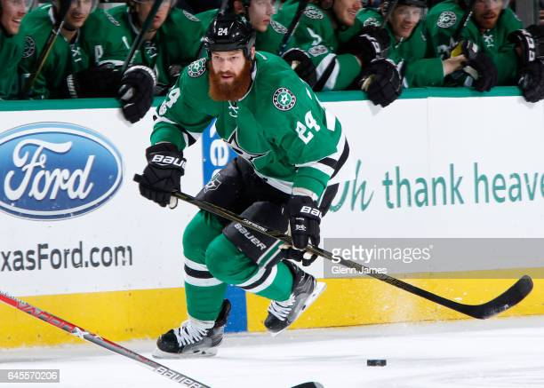 Jordie Benn of the Dallas Stars handles the puck against the Arizona Coyotes at the American Airlines Center on February 24 2017 in Dallas Texas