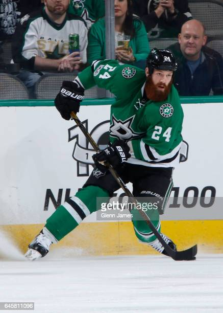 Jordie Benn of the Dallas Stars handles the puck against the Boston Bruins at the American Airlines Center on February 26 2017 in Dallas Texas