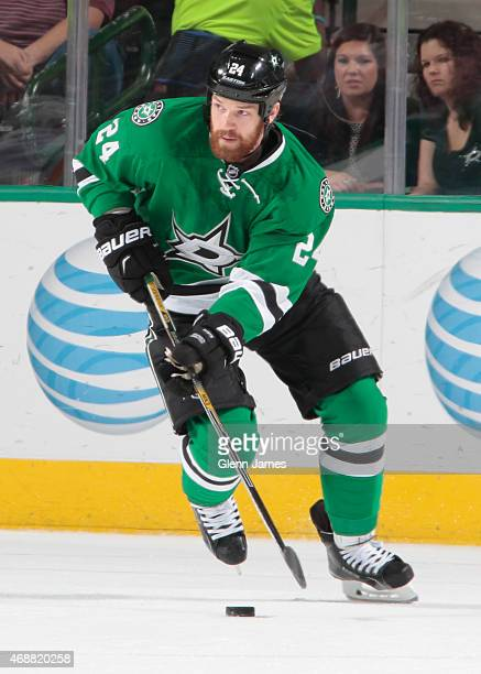Jordie Benn of the Dallas Stars handles the puck against the Buffalo Sabres at the American Airlines Center on March 23 2015 in Dallas Texas