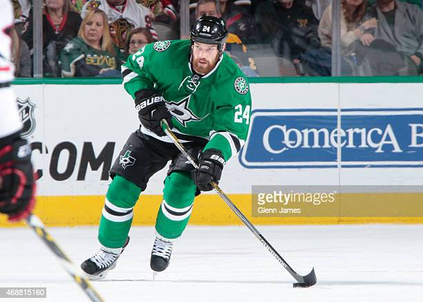 Jordie Benn of the Dallas Stars handles the puck against the Chicago Blackhawks at the American Airlines Center on March 21 2015 in Dallas Texas