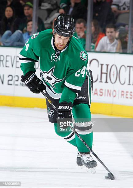 Jordie Benn of the Dallas Stars handles the puck against the Edmonton Oilers at the American Airlines Center on January 14 2014 in Dallas Texas