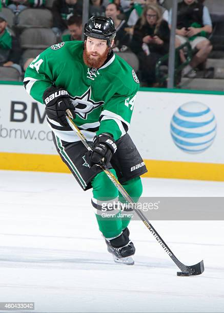Jordie Benn of the Dallas Stars handles the puck against the New Jersey Devils at the American Airlines Center on December 13 2014 in Dallas Texas