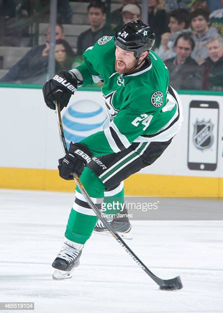Jordie Benn of the Dallas Stars handles the puck against the New York Islanders at the American Airlines Center on March 3 2015 in Dallas Texas