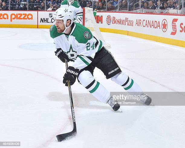 Jordie Benn of the Dallas Stars plays the puck up the ice during first period action against the Winnipeg Jets on February 24 2015 at the MTS Centre...