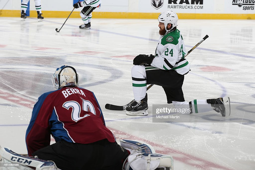 Jordie Benn of the Dallas Stars stretches near goaltender Reto Berra of the Colorado Avalanche prior to the game at the Pepsi Center on January 10...