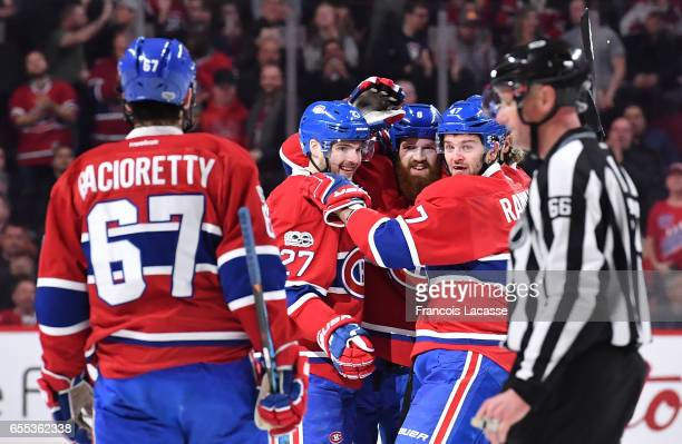 Jordie Benn of the Montreal Canadiens celebrates after scoring a goal against the Ottawa Senators in the NHL game at the Bell Centre on March 19 2017...