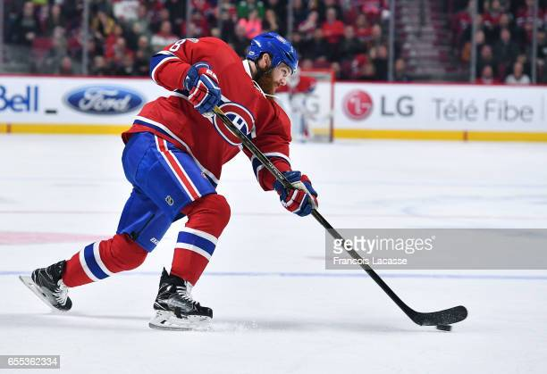 Jordie Benn of the Montreal Canadiens fires a slap shot against the Ottawa Senators in the NHL game at the Bell Centre on March 19 2017 in Montreal...