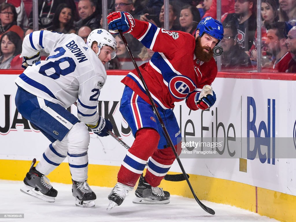 Jordie Benn #8 of the Montreal Canadiens skates after a bouncing puck with Connor Brown #28 of the Toronto Maple Leafs behind him during the NHL game at the Bell Centre on November 18, 2017 in Montreal, Quebec, Canada. The Toronto Maple Leafs defeated the Montreal Canadiens 6-0.