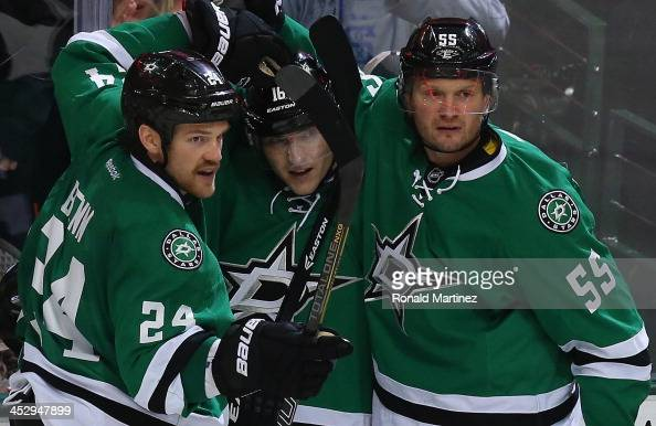 Jordie Benn Ryan Garbutt and Sergei Gonchar of the Dallas Stars celebrate a goal against the Edmonton Oilers in the third period at American Airlines...