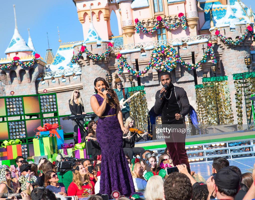 Jordin Sparks and Jason Derulo perform 'Baby It's Cold Outside' during a taping for the 'Disney Parks Christmas Day Parade' television special at Disneyland on November 9, 2013 in Anahiem, California. 'Disney Parks Christmas Day Parade' airs December 25 on ABC.