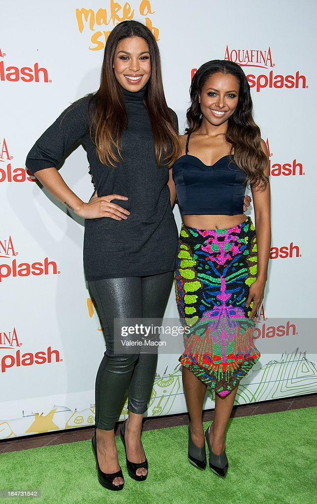Jordin Sparks and Kat Graham arrives at Aquafina FlavorSplash Launch Party With Austin Mahone & Nick Cannon at Sony Pictures Studios on October 15, 2013 in Culver City, California.