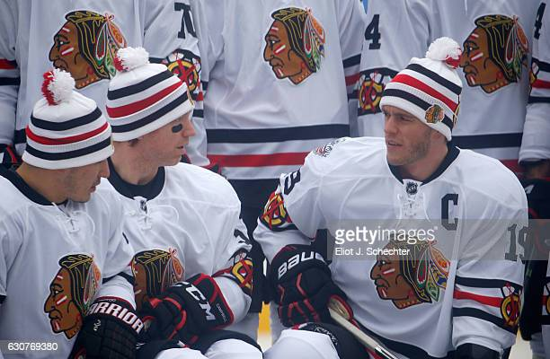 Jordin Tootoo Brian Campbell and Jonathan Toews of the Chicago Blackhawks wait with teammates prior to taking a team photo before practice for the...