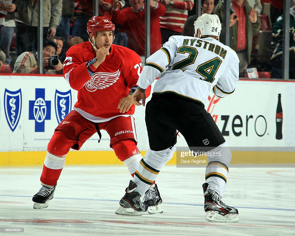 Jordin Tootoo #22 of the Detroit Red Wings and Eric Nystrom #24 of the Dallas Stars square up to fight during an NHL game at Joe Louis Arena on January 29, 2013 in Detroit, Michigan.