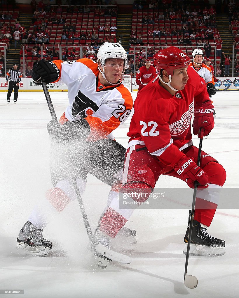 <a gi-track='captionPersonalityLinkClicked' href=/galleries/search?phrase=Jordin+Tootoo&family=editorial&specificpeople=203013 ng-click='$event.stopPropagation()'>Jordin Tootoo</a> #22 of the Detroit Red Wings and <a gi-track='captionPersonalityLinkClicked' href=/galleries/search?phrase=Erik+Gustafsson+-+Ice+Hockey+Player+-+Born+1988&family=editorial&specificpeople=10836949 ng-click='$event.stopPropagation()'>Erik Gustafsson</a> #26 of the Philadelphia Flyers battle for positoin during a NHL game at Joe Louis Arena on October 12, 2013 in Detroit, Michigan. Detroit defeated Philadelphia 5-2.