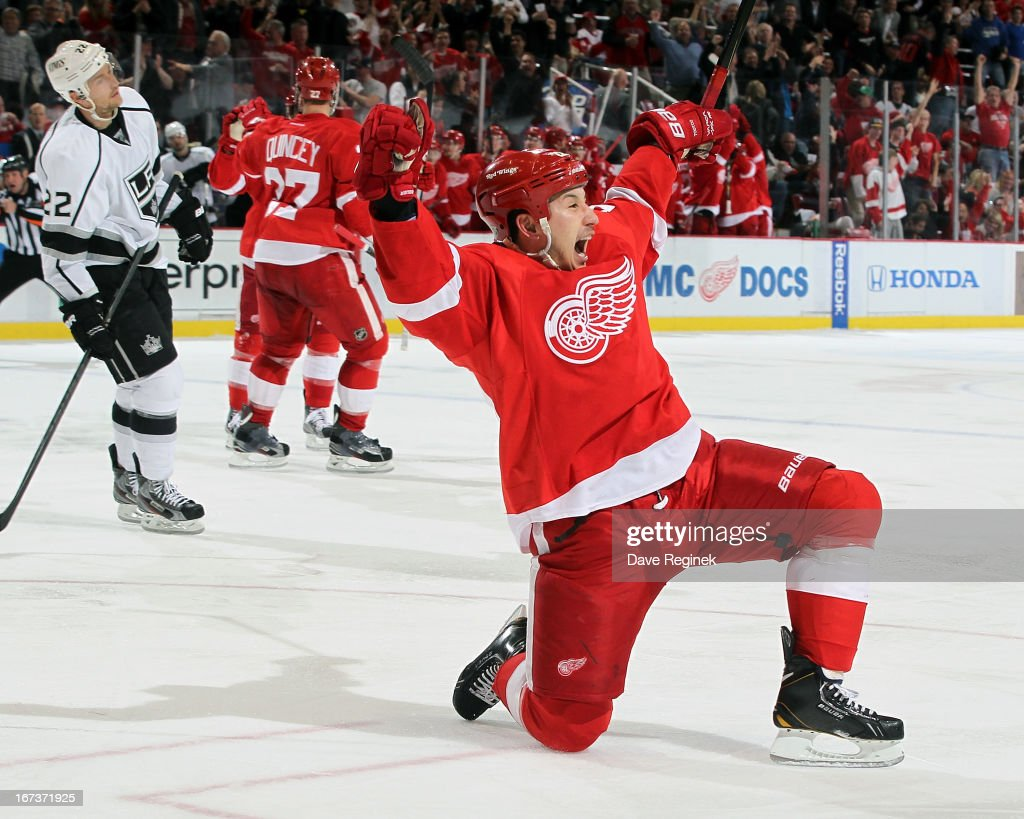 Jordin Tootoo #22 of the Detroit Red Wings drops to one knee and celebrates after scoring a goal as Trevor Lewis #22 of the Los Angeles Kings can only watch during a NHL game at Joe Louis Arena on April 24, 2013 in Detroit, Michigan.