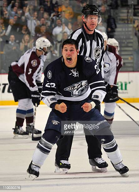Jordin Tootoo of the Nashville Predators plays to the fans after a fight against Ryan Wilson of the Colorado Avalanche during an NHL game on March 12...
