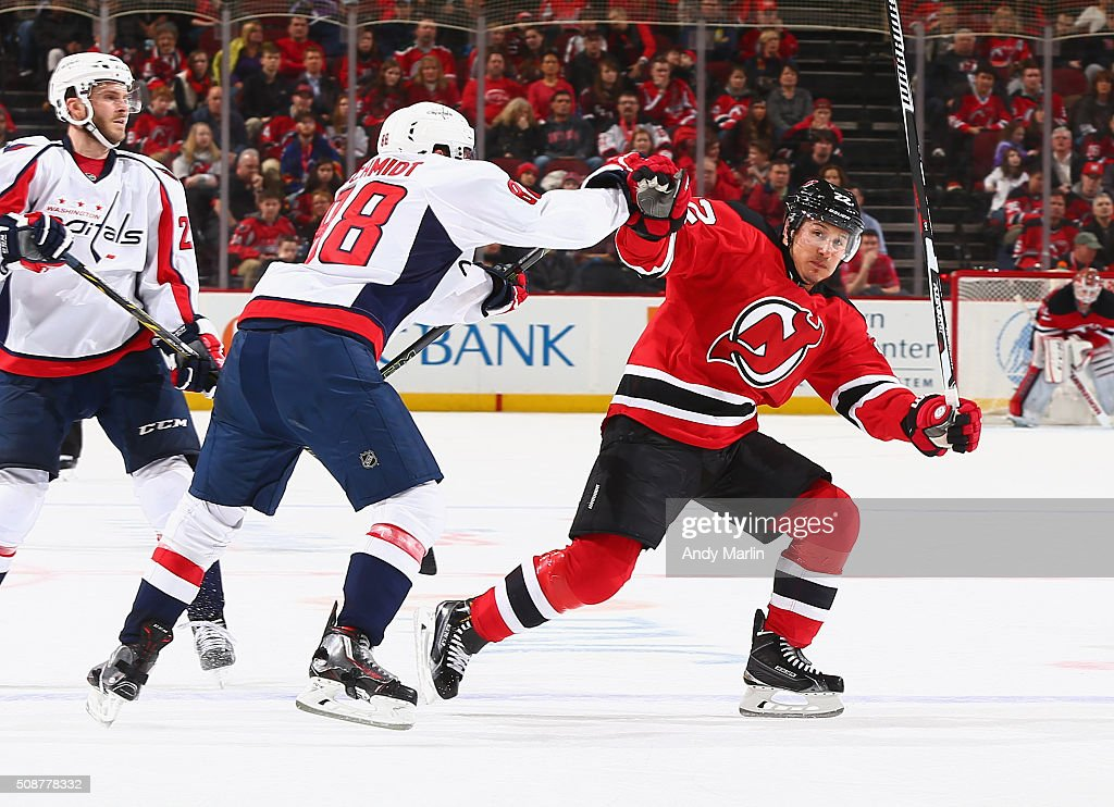 <a gi-track='captionPersonalityLinkClicked' href=/galleries/search?phrase=Jordin+Tootoo&family=editorial&specificpeople=203013 ng-click='$event.stopPropagation()'>Jordin Tootoo</a> #22 of the New Jersey Devils and <a gi-track='captionPersonalityLinkClicked' href=/galleries/search?phrase=Nate+Schmidt&family=editorial&specificpeople=8280743 ng-click='$event.stopPropagation()'>Nate Schmidt</a> #88 of the Washington Capitals come together during the game at the Prudential Center on February 6, 2016 in Newark, New Jersey.