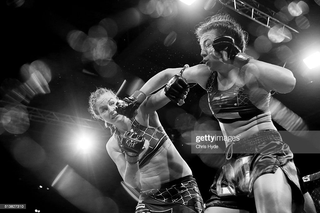 WHITE Jordina Baars and Steph Glew exchange punches during the Cage Muay Thai 8 bout at Logan Metro Sports Centre on March 4 2016 in Brisbane...