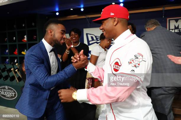 Jordon Adell is congratulated by Hunter Greene after being selected 10th overall by the Angels during the 2017 Major League Baseball Draft at Studio...