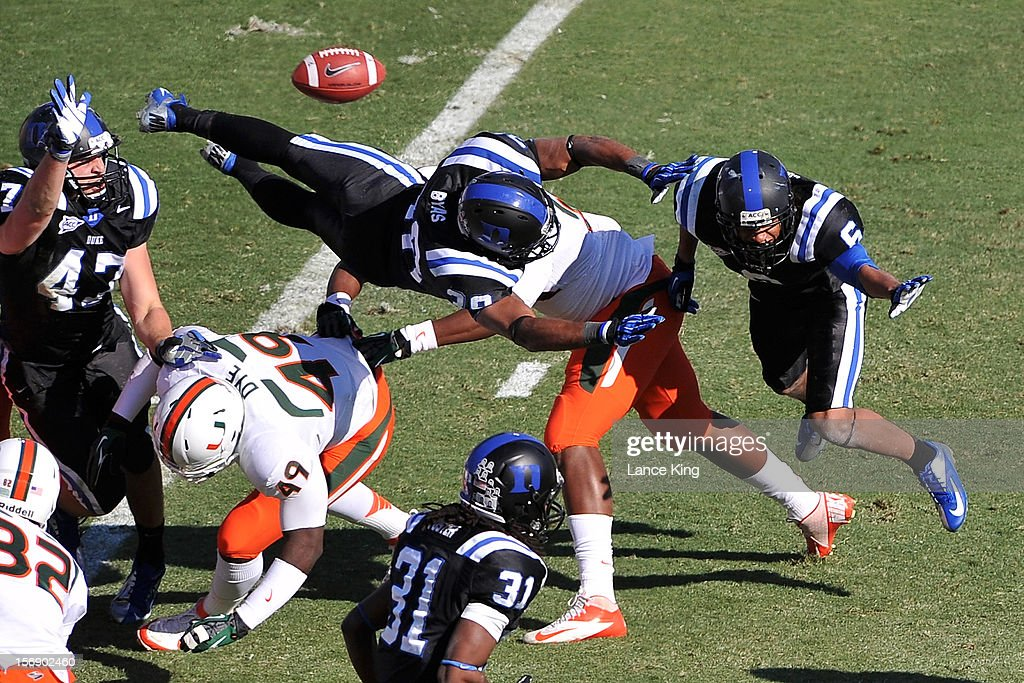 Jordon Byas #38 of the Duke Blue Devils tries to block a point after attempt against the Miami Hurricanes at Wallace Wade Stadium on November 24, 2012 in Durham, North Carolina.