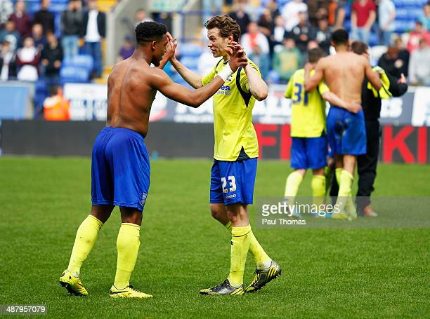 Jordon Ibe and Jonathan Spector of Birmingham City celebrate as they avoid relegation after the Sky Bet Championship match between Bolton Wanderers...