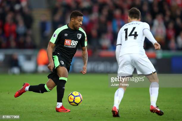 Jordon Ibe of AFC Bournemouth and Tom Carroll of Swansea City battle for the ball during the Premier League match between Swansea City and AFC...