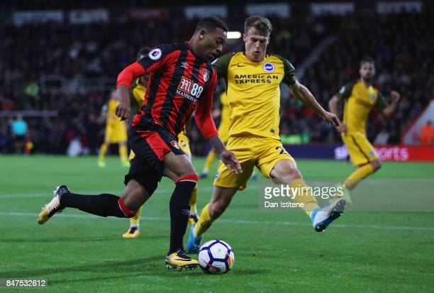 Jordon Ibe of AFC Bournemouth takes on Solly March of Brighton and Hove Albion during the Premier League match between AFC Bournemouth and Brighton...