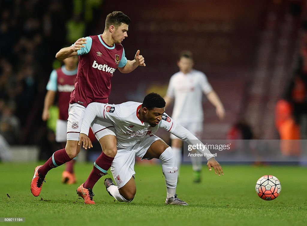 <a gi-track='captionPersonalityLinkClicked' href=/galleries/search?phrase=Jordon+Ibe&family=editorial&specificpeople=10824998 ng-click='$event.stopPropagation()'>Jordon Ibe</a> of Liverpool brought down by <a gi-track='captionPersonalityLinkClicked' href=/galleries/search?phrase=Aaron+Cresswell&family=editorial&specificpeople=6175637 ng-click='$event.stopPropagation()'>Aaron Cresswell</a> of West Ham United during the The Emirates FA Cup Fourth Round Replay match between West Ham United and Liverpool at Boleyn Ground on February 9, 2016 in London, England.