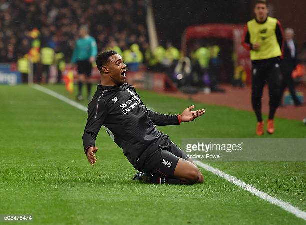 Jordon Ibe of Liverpool celebrates after scoring the opening goal during the Capital One Cup semi final first leg match between Stoke City and...